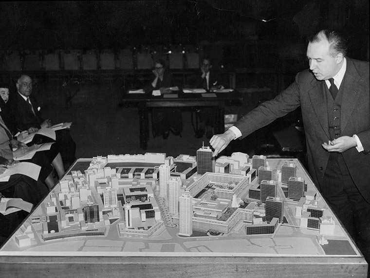 Peter Chamberlain with early model of Barbican Estate